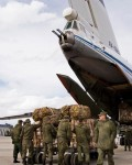 Russian air force personnel prepare to load humanitarian cargo on board a Syrian Il-76 plane at Hemeimeem air base in Syria. Russia's defense ministry said Tuesday, March 15, 2016 that the first group of warplanes stationed at the Russian air base in Syria has left for home following a pullout order from President Vladimir Putin.(Photo:Ap)