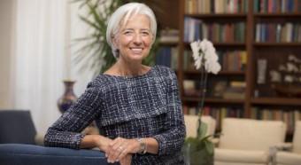 Christine Lagarde vventer lavere vekst. Her er  hun avbildet etter å ha blitt gjenvalgt i IMF( Foto: IMF
