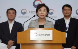 South Korean Minister of Land Infrastructure and Transport, Kim Hyun-mee, center, speaks at a press conference at the government complex in Seoul, South Korea